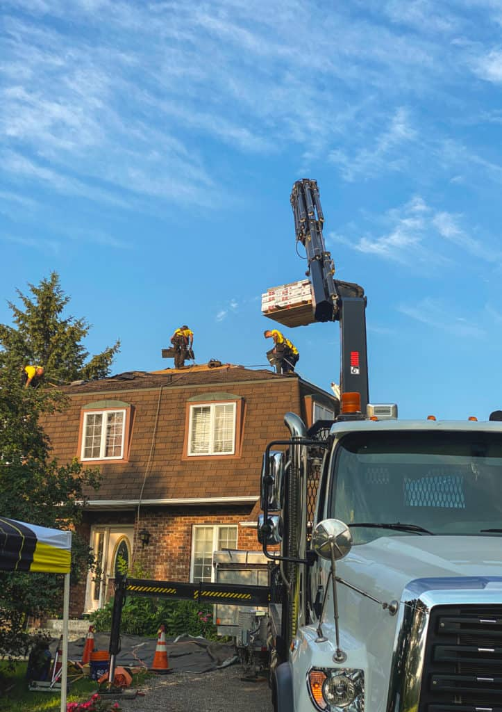 shingles being added to roofing job in Ottawa