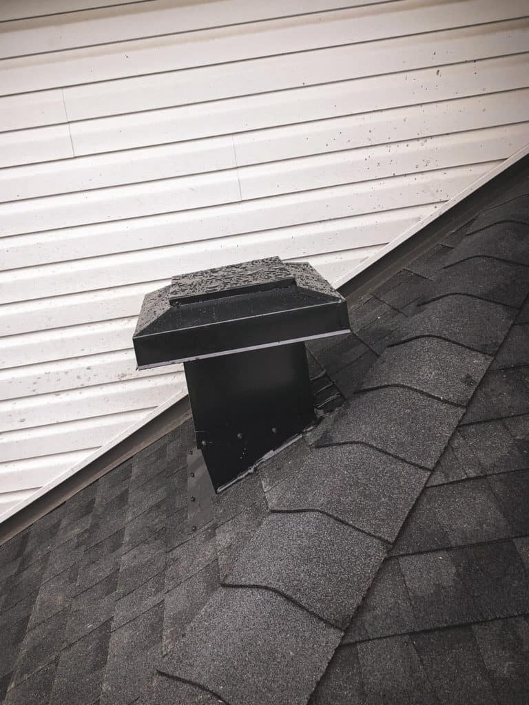 new roof with brown shingles and ventilation system